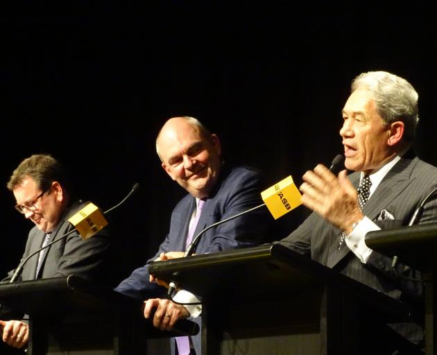 New Zealand First leader Winston Peters makes a point during a pre-election political debate in Queenstown last night as Labour finance spokesman Grant Robertson (left) and Finance Minister Steven Joyce listen. Photo: Guy Williams