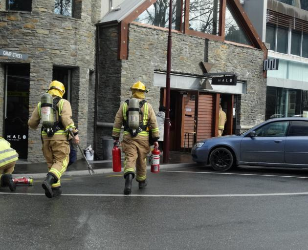 Queenstown fire volunteers approach Halo cafe in central Queenstown yesterday. Photo: David Williams