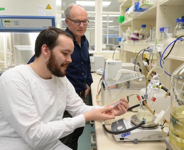 Dr Kiel Hards (foreground), watched by Prof Greg Cook, uses a chemostat in a laboratory at the University of Otago yesterday. Photo: Linda Robertson
