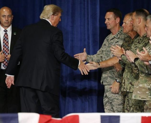 US President Trump shakes hands with officers after announcing his new policy for the war in Afghanistan. Photo: Reuters