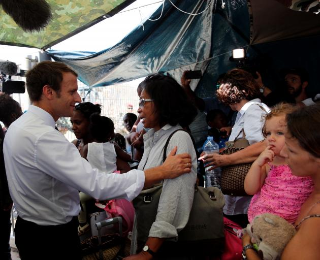 President Emmanuel Macron comforts residents during his visit to the French Caribbean island of St Martin. Photo: Reuters