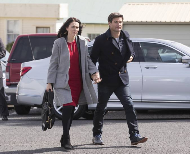 Labour leader Jacinda Ardern and partner Clarke Gayford arrive at St David's Cooperating Parish in Te Aroha for the funeral of Ardern's grandmother. Photo: NZME