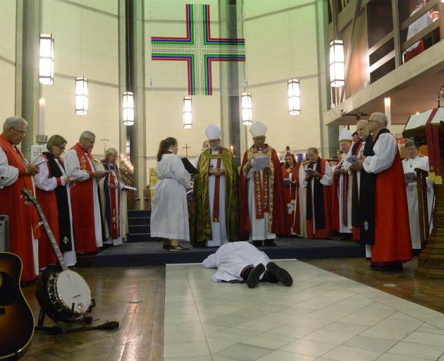 Dr  Benford prostrates in silence in front of the altar during his installation as Anglican...