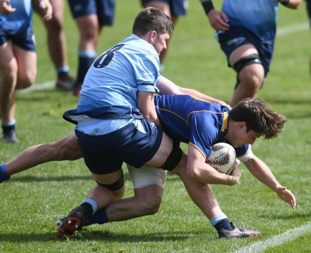 Otago first five-eighth George Witana fights through a tackle to score one of eight Otago tries....