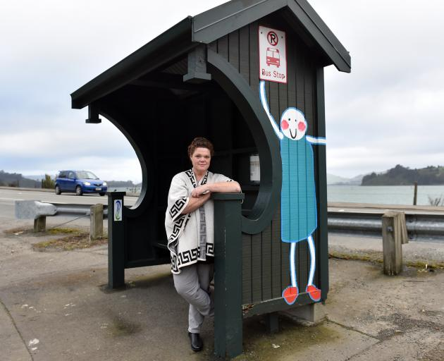St Leonards resident Megan Sinclair stands at her local bus stop from where buses will next term cease taking her son directly to Dunedin North Intermediate. Photo: Peter McIntosh