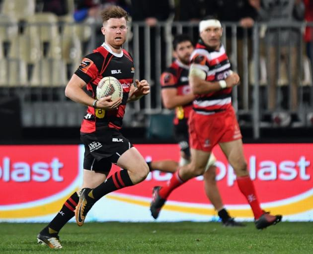Canterbury halfback Mitchell Drummond on the way to scoring one of his four first half tries...