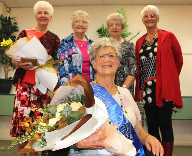 Alexandra Blossom Festival Senior Queen Esther McKay takes her throne yesterday in front of other contestants (from left:) runner-up Margaret Ruffell, Shirley Bell, Mary Boyd and Jeanette McKay, all of Alexandra. Photo: Jono Edwards