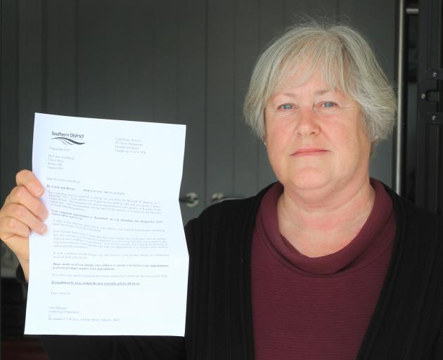 Carol Bryan, of Oamaru, holds a letter from the Southern District Health Board advising her that...