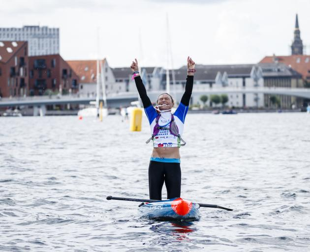 Annabel Anderson, of Queenstown, wins the distance event at the World Stand-up and Paddleboard...