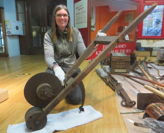 North Otago Museum curator Chloe Searle with the remaining unidentified mystery item. PHOTO: SHANNON GILLIES