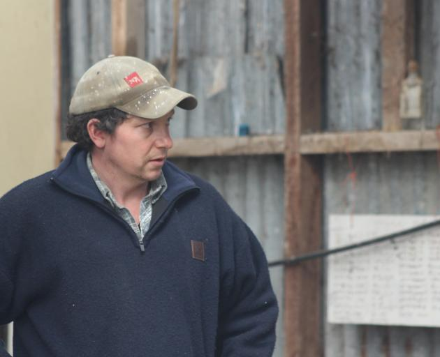 Ross Paterson talks about his family's robotic lamb feeders and their rearing operation at the Waikaka Genetics lamb-rearing field day recently. Photo: Nicole Sharp