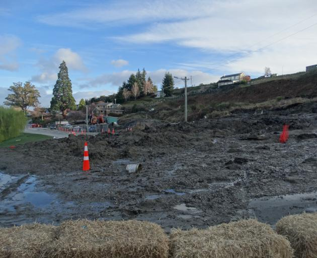 A slow moving slip on the Marina Terrace construction site on Lakeside Rd in Wanaka overnight has blocked the road to all traffic. Photo: Kerrie Waterworth