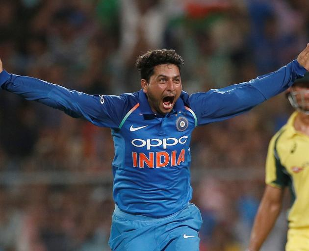 India's Kuldeep Yadav celebrates his hat-trick against Australia after dismissing Pat Cummins....