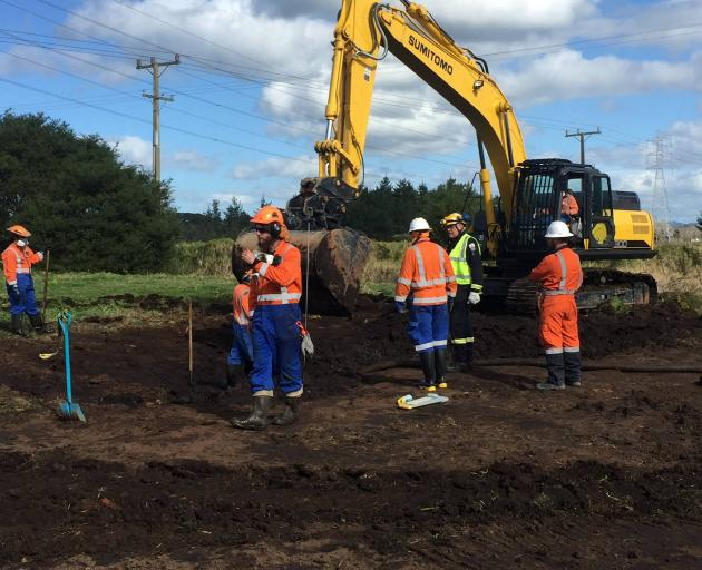 Workers at the site of the damaged pipeline in Northland that supplies Auckland Airport. Photo:...