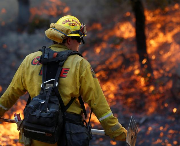 Firefighters worked to defend homes from an approaching wildfire in Sonoma. Photo: Reuters