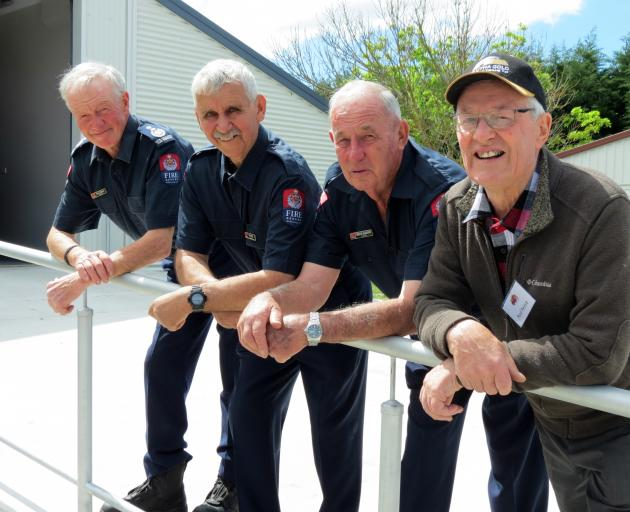Four chief fire officers gathered together to celebrate the Millers Flat and Ettrick Volunteer Fire Brigade's 50th anniversary at Millers Flat on Saturday. From left are current brigade CFO Brian Timpson, of Millers Flat, who took over from Wes Reichel, a
