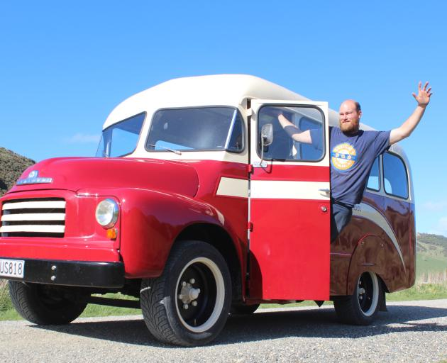 Lyndon McNab with the renovated school bus ''Rona'' which will be used to transport wedding...