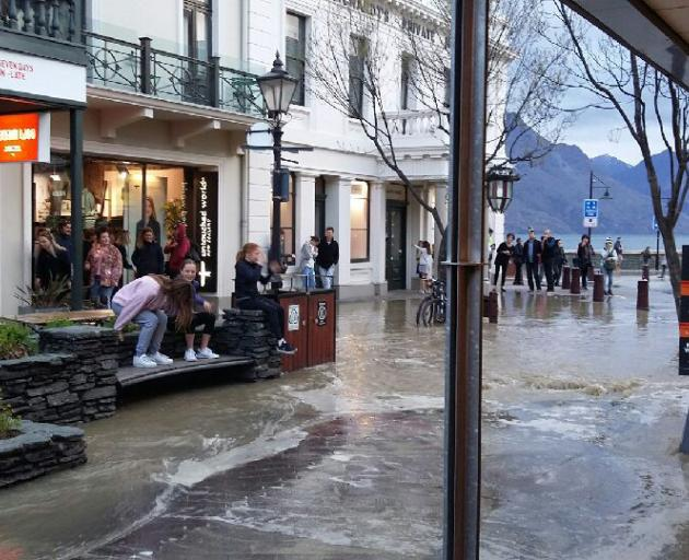 Flooding from a burst water pipe in Ballarat St, Queenstown, yesterday. Photo: John Knox