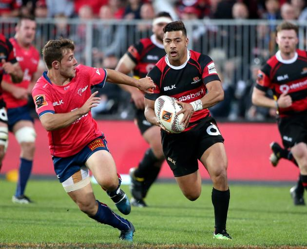 Richie Mo'unga of Canterbury breaks away to score a try during the Mitre 10 Cup Premiership Final match between Canterbury and Tasman. Photo: Getty Images