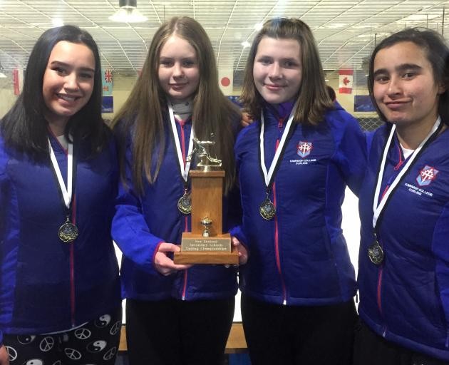 The successful Kavanagh College curling team of (from left) Temika Bishop, Emily Armstrong, Elizabeth Audas and Grace Bishop with the trophy after winning the national title in Auckland on Monday night. Photo: Supplied