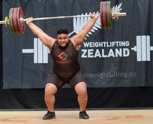 David Liti (21) snatches 153kg on the way to securing his third national Olympic weightlifting...