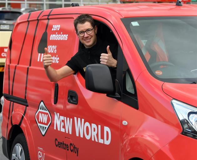 Dunedin Centre City New World owner Craig Nieper in the supermarket's electric van. PHOTO:...