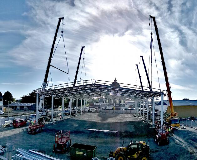 Tuatara Structures erects the roof of Invercargill's new trampoline park on the corner of Nith and Tyne Sts on Saturday. Photo: Supplied