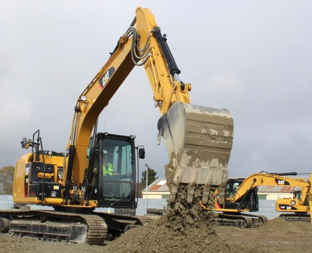 One of the first participants tries out a 15-tonne digger at Dig This Invercargill on the opening...