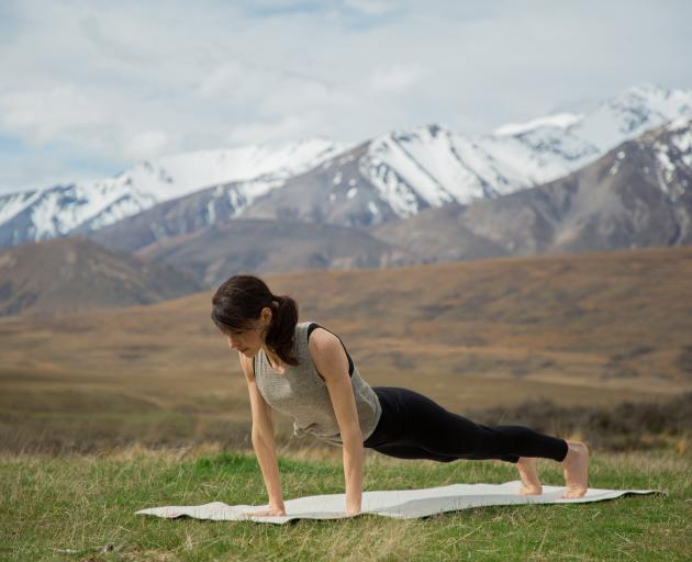 A Fifth Breath yoga mat gets a workout in the New Zealand countryside. Photo: Supplied