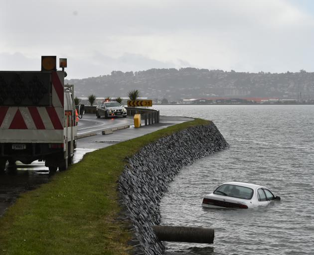 A car crashed into Otago Harbour this afternoon. Photo: Gregor Richardson