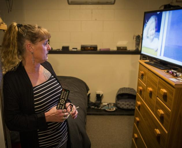 At her home in Oxford, near Christchurch, Nicola Cruickshank watches a recorded version of the...