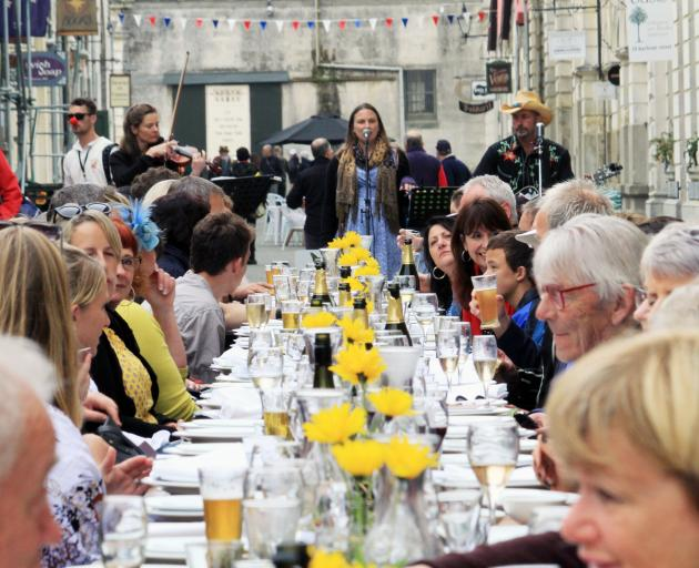More than 70 people gather in Harbour St in April for the Forrester Laneway Long Lunch. Photo: Hamish MacLean
