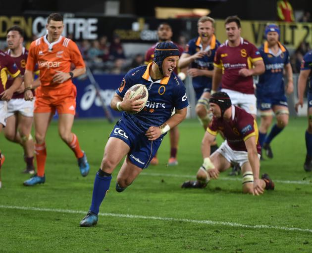 Otago's Tei Walden dashes for the line to score a try in the second half of their match against Southland at Forsyth Barr Stadium. Photo: Gregor Richardson