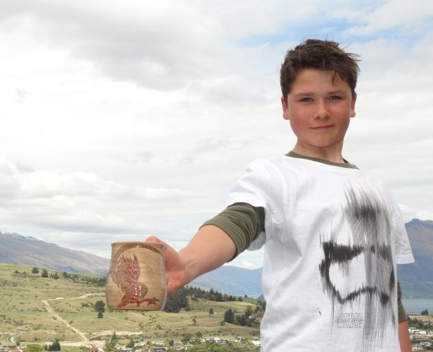 Queenstown youngster Peter Bodie-Healy shows the flagon he designed with Weta Workshop staff...
