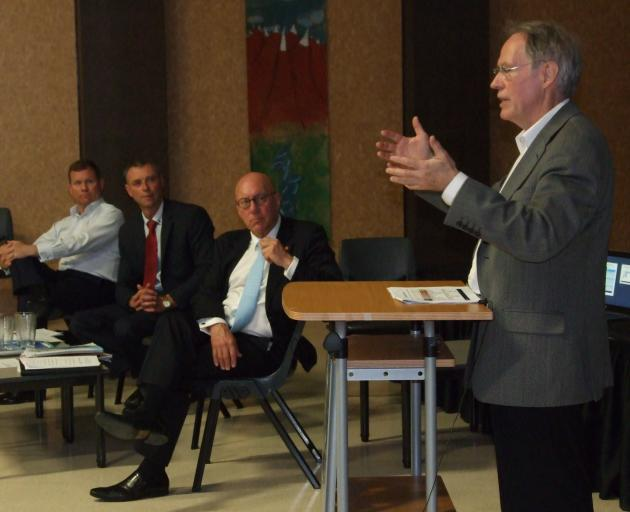 NZ Transport Agency southern regional director Jim Harland (right) speaks at a public meeting in...