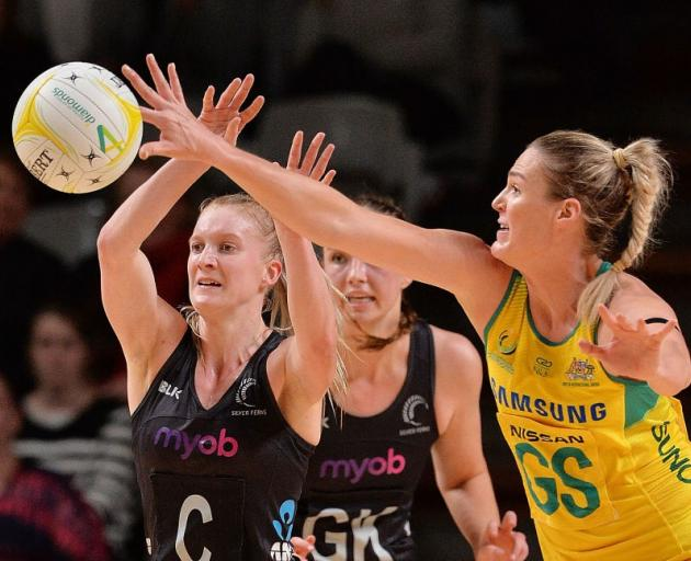 Australia's Caitlin Bassett intercepts a pass from the Silver Ferns' Shannon Francois during last...