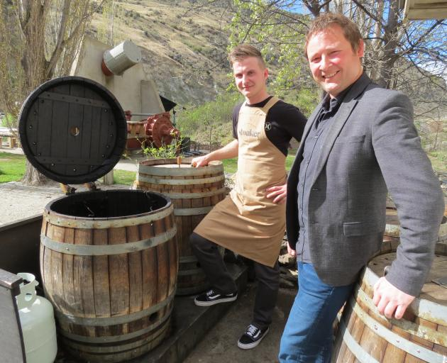 Wild Earth Wines' 2014 and 2015 pinot noirs have done well in competition this year. Their biggest market is visitors to the cellar door at Kawarau Gorge. Head chef George Sumara (left) and marketing manager Elbert Jolink, pictured by wine barrels that ha