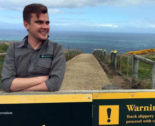 Department of Conservation recreation, historic and biodiversity ranger Shay van der Hurk at the start of the track to Tunnel Beach in Dunedin. PHOTO: SHAWN MCAVINUE