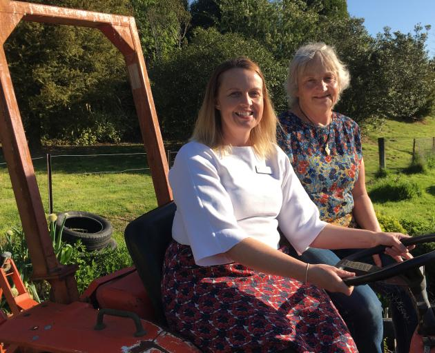Greater Green Island Community Network worker Amanda Reid (left) and Green Island Community Garden co-ordinator Marion Thomas on the tractor in the garden where fruit trees, funded by the Otago Community Trust, will be planted. PHOTO: SHAWN MCAVINUE