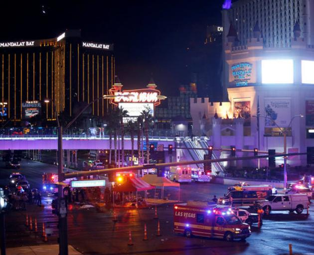 Las Vegas Metro Police and medical workers stage after a mass shooting at a music festival on the Las Vegas Strip. Photo: Reuters