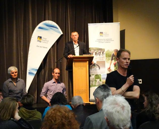 Guest speakers (from left) freshwater scientist Dr Marc Schallenberg and Landcare researcher Dr Phil Novis and ORC chairman Stephen Woodhead (at podium) listen to Queenstown Lakes District Council project manager Rob Darby at the lake snow information eve