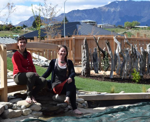 Early childhood teachers Enger Pelosi-Fear and Pip O'Connell relax in the grounds of Kanuka...