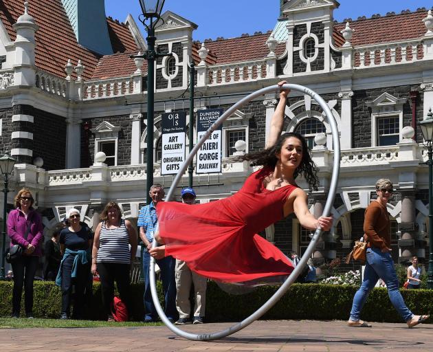 Cirkopolis acrobat Rosita Hendry performs with a Cyr wheel at the Dunedin Railway Station yesterday. Photo: Stephen Jaquiery