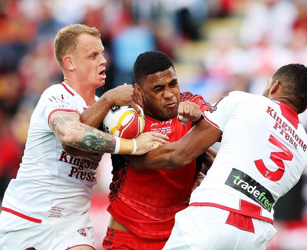 Michael Jennings of Tonga charges forward during the 2017 Rugby League World Cup Semi Final match...