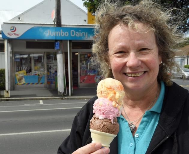 Jumbo Dairy manager Debbie Green eyes up an ice cream which has been kept cold thanks to the use...