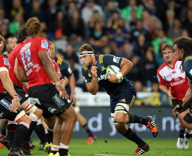 Luke Whitelock carries the ball for the Highlanders against the Lions. Photo: Getty Images