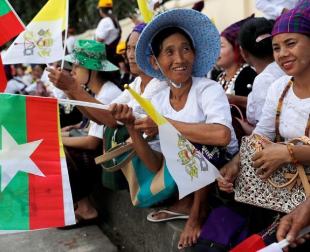 People gather outside the the residence of Cardinal Charles Maung Bo, Archbishop of Yangon, where Pope Francis will be staying during his visit in Yangon. Photo: Reuters