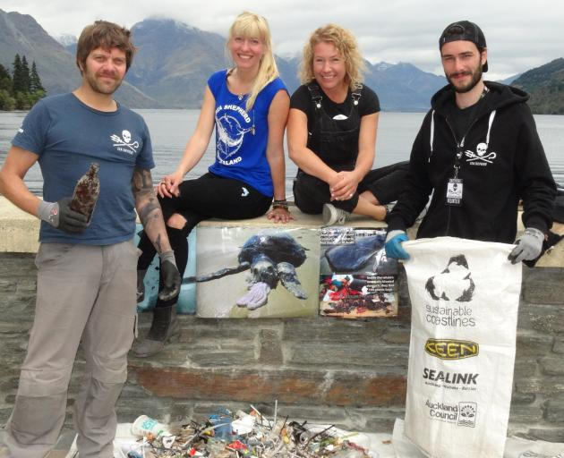 Cleaning up Queenstown's waterfront on Saturday were (from left) co-ordinator Rob Dickinson and...