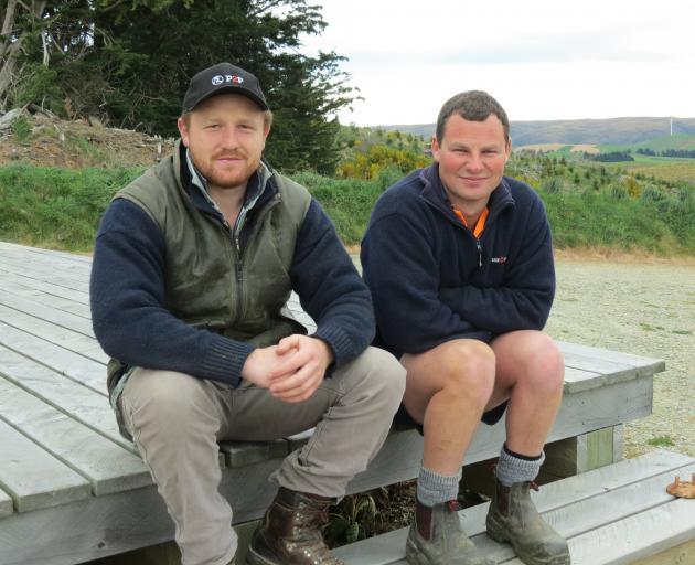 Logan Bain (left) and Caleb Neilson, of Thornicroft Station, near Lake Mahinerangi, both enjoy working with deer. Photo: Yvonne O'Hara