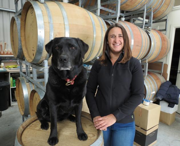 Debra Cruikshank, of Tannacrieff Wines, Cromwell, with her ``Lab'' assistant Jade, was named as winner of the Rural Women New Zealand's Swazi New Zealand Entrepreneurial Enterprising Rural Women Award recently. Photo: Yvonne O'Hara